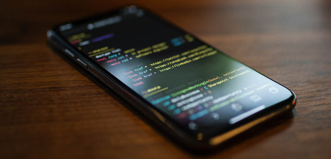 Phone with HTML of a website's source code displayed